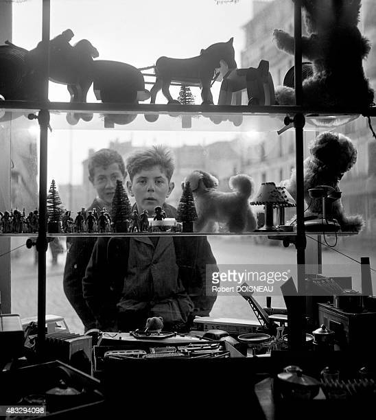 Boys in front of a Christmas shop window 1947 in Montrouge France