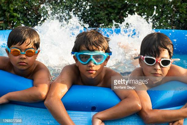 boys in swimming pool, wearing goggles - google stock pictures, royalty-free photos & images