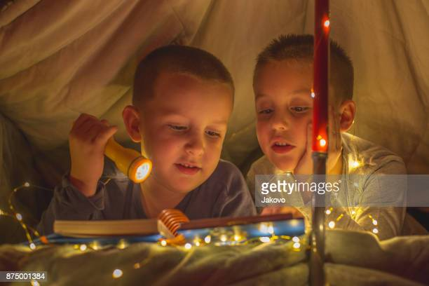 boys in tent - 2 5 months stock pictures, royalty-free photos & images