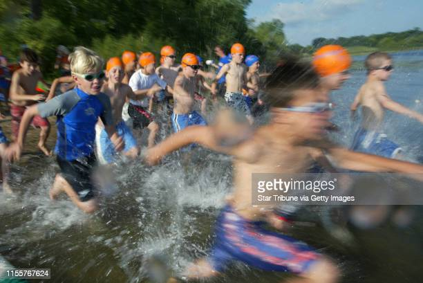 Boys in the age 9-10 wave race into Lake Ann to begin the one lap swim at the Miracle Kids Triathlon Sunday at Lake Ann Park in Chanhassen. 280...