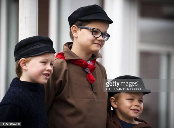 Boys in traditional Scheveningen costume attend the 72nd edition of Vlaggetjesdag marking the official start of the herring season in Scheveningen on...