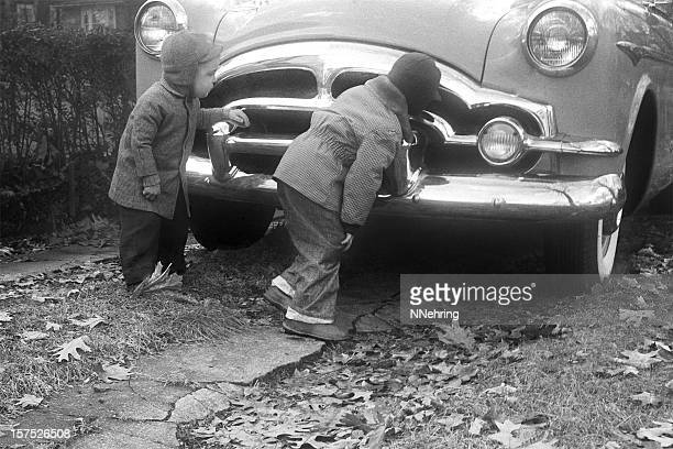 boys inspecting packard coupe car 1955, retro - 1955 stock pictures, royalty-free photos & images