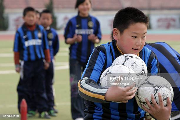 Boys involved in the Intercampus project attend a training session on March 31 2008 in Qingdao China Since 1997 Inter Campus has implemented a...