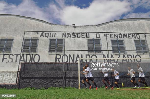 Boys jog during a training session at Sao Cristovao football club in Rio de Janeiro Brazil on February 7 2018 Tiny Sao Cristovao Football Club gave...