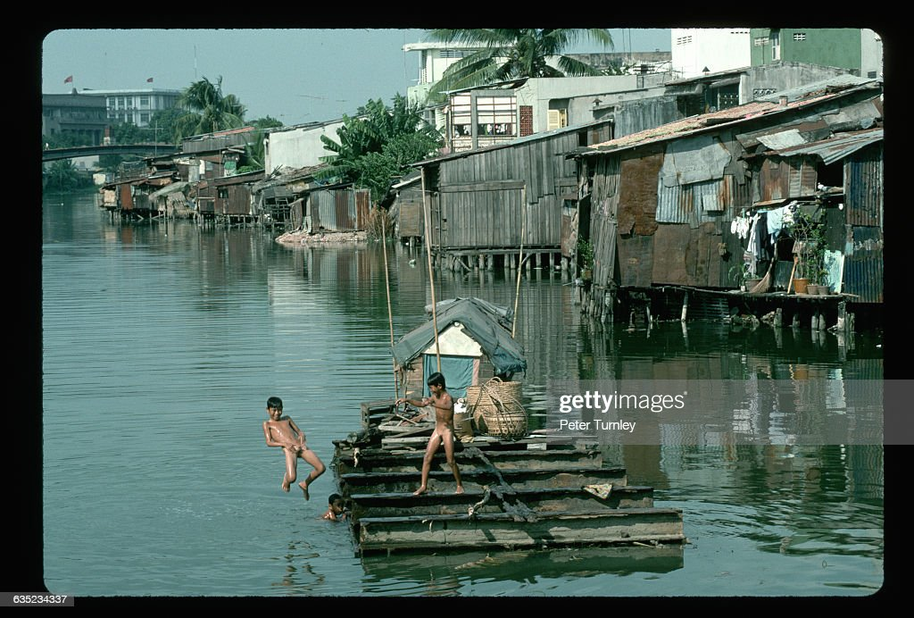 Boys Jump Into A River From A Dock In A Riverside Slum Outside Of Ho News Photo -8688