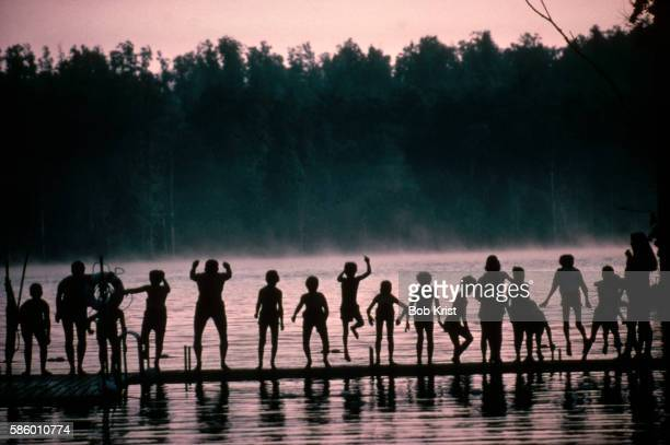 Boys Jumping From a Dock