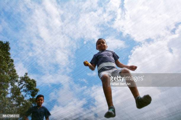 Boys jumps on a trampoline