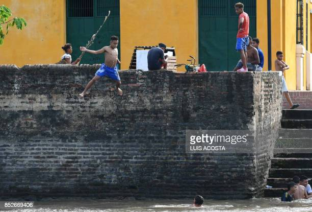 Boys jumps to Magdalena river in Santa Cruz de Mompox Department of Bolivar September 23 2017 the Colombian town on the banks of the great river...