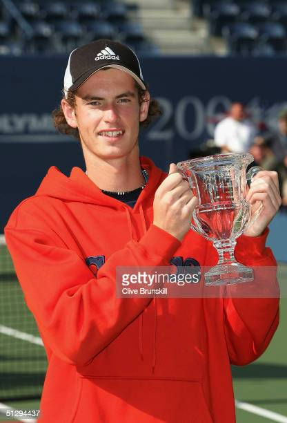 Boy's Junior winner Andrew Murray of Great Britain stands with his trophy during the US Open September 12 2004 at the USTA National Tennis Center in...