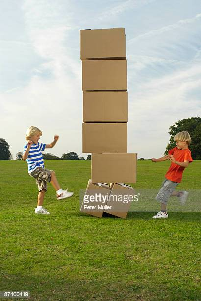 boys kicking boxes