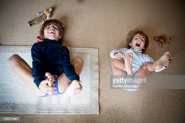 boys laughing and playing with toys - bambini in mutande foto e immagini stock