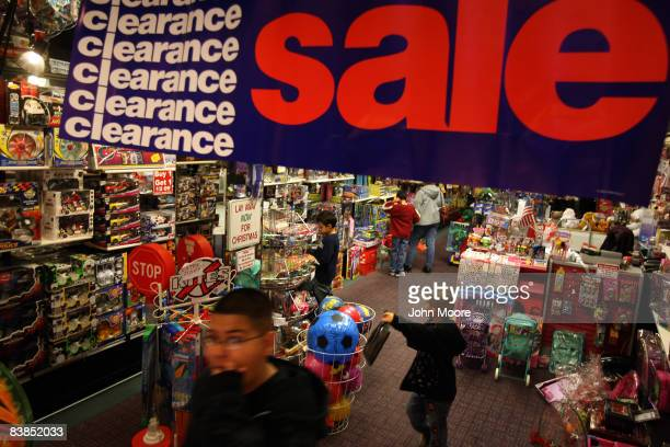 Boys leave a toy store during 'Black Friday' at a shopping mall November 28 2008 in Aurora Colorado Retailers in Aurora which has suffered one of the...