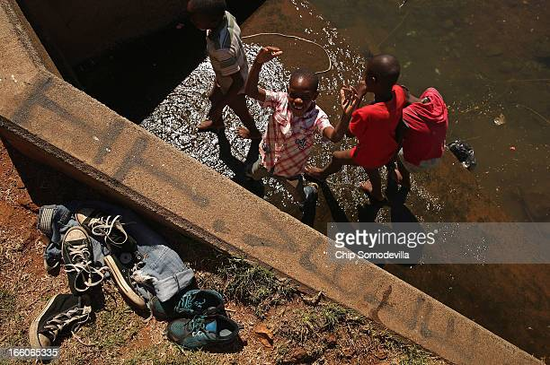 Boys leave their clothes aside while playing in a large culvert in Thokoza Park April 8 2013 in Johannesburg South Africa Thokoza Park is situated...