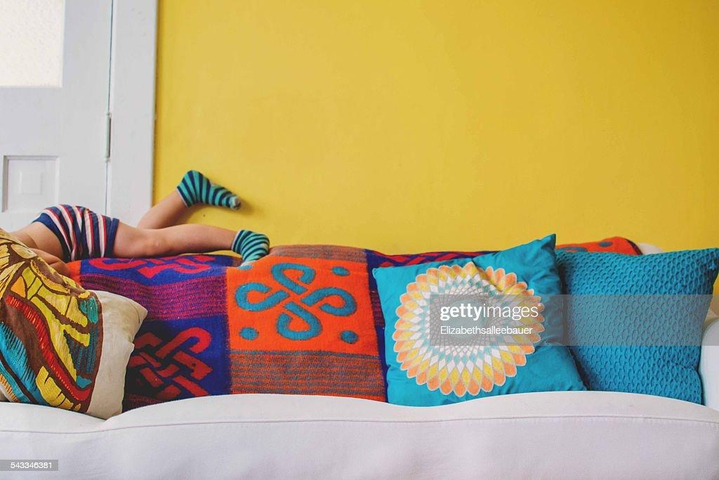 Boy's (2-3) legs on sofa : Stock Photo