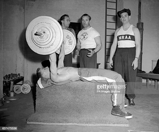 Boys lift weights