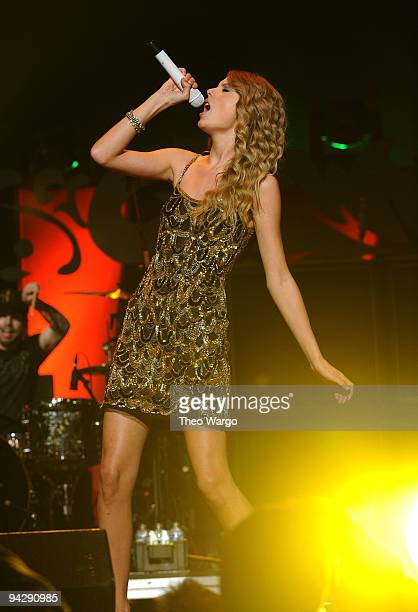 Boys Like Girls performs onstage with Taylor Swift during Z100's Jingle Ball 2009 presented by HM at Madison Square Garden on December 11 2009 in New...