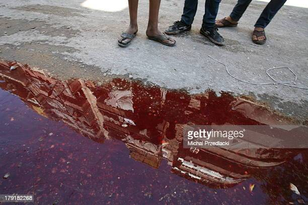 Boys look at a pool of blood of one of ten victims of shelling at Bustan Al Qasr. On July 24th Syrian Army Forces have shelled residential area of...