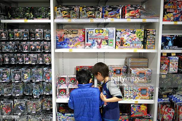 Boys look at Pokemon toys displayed for sale at the Pokemon Center Mega Tokyo store in Tokyo Japan on Wednesday Feb 24 2016 Pokemon a multimedia...
