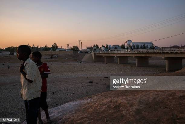Boys look out over a dried riverbed on February 27 2017 in Garowe Somalia Somalia is currently on the brink of famine with over half of the country's...