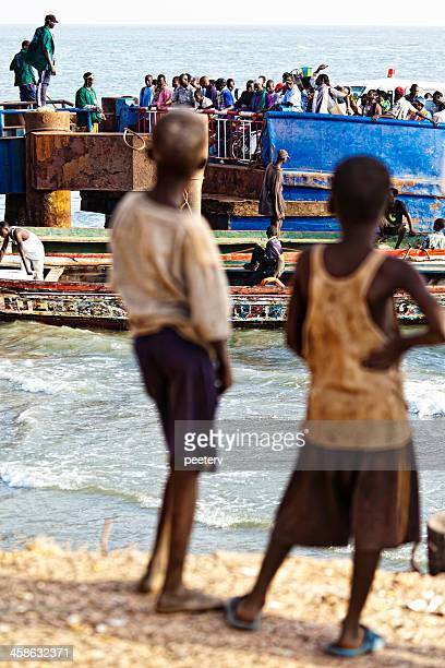 boys looking at crowd. - banjul stock pictures, royalty-free photos & images