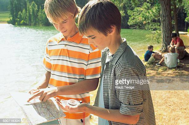 Boys looking at map and compass