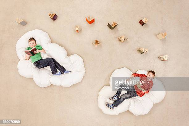 Boys lying on clouds, reading
