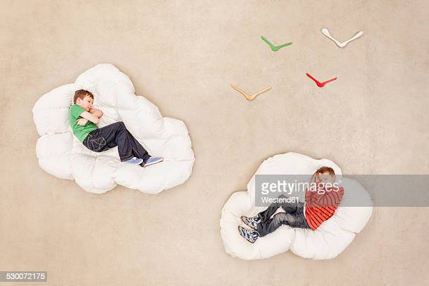Boys lying on clouds sleeping