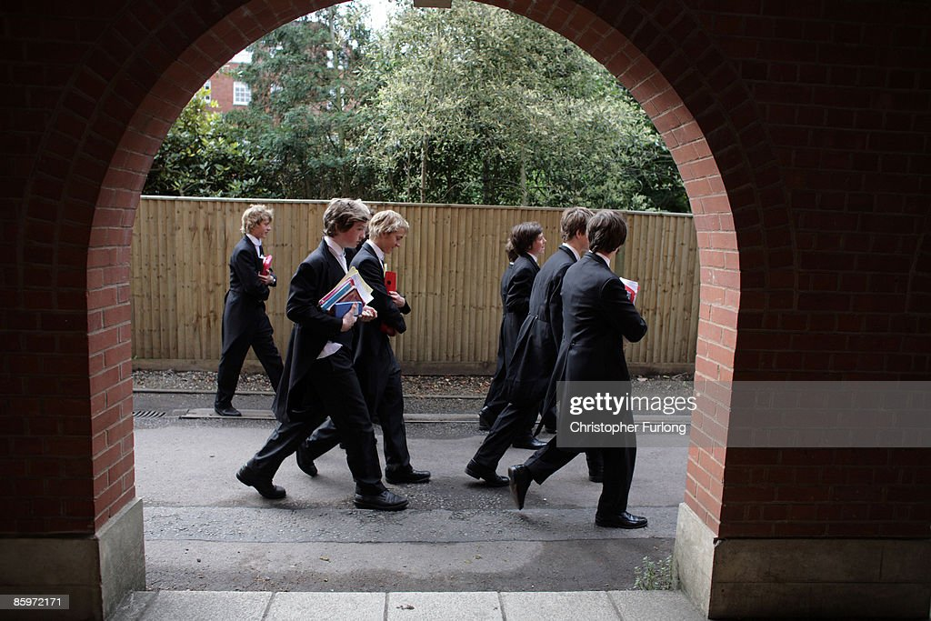 Boys make their way to classes at Eton College on July 20, 2008, in Eton, England. An icon amongst private schools, since its founding in 1440 by King Henry VI, Eton has educated 18 British Prime Ministers, as well as prominent authors, artists and members of royal families from around the world. The school caters for some 1300 pupils divided into 25 houses each one overseen by a housemaster chosen from the senior ranks of the staff which number around 160.