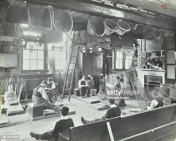 Boys making baskets at Linden Lodge Residential School, Battersea, Wandsworth, London, 1908. Workshop with boys making baskets and cribs, with...