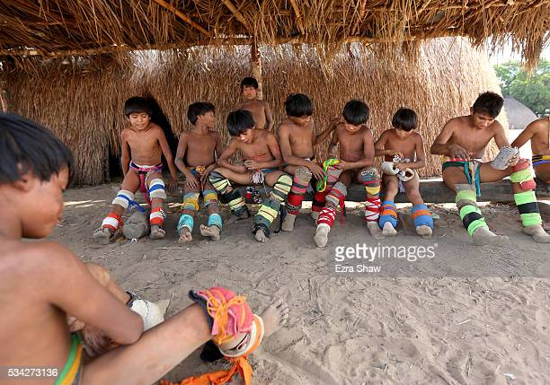 Boys of all ages participate in the afternoon hukahuka wrestling matches on May 10 in the village of Kamayura Brazil
