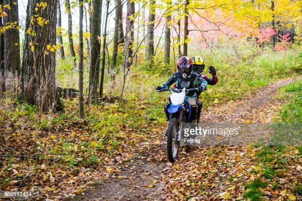 Boys on a dirt bike