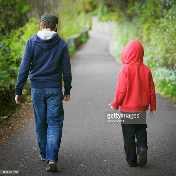 boys on a walk - cork city stock pictures, royalty-free photos & images