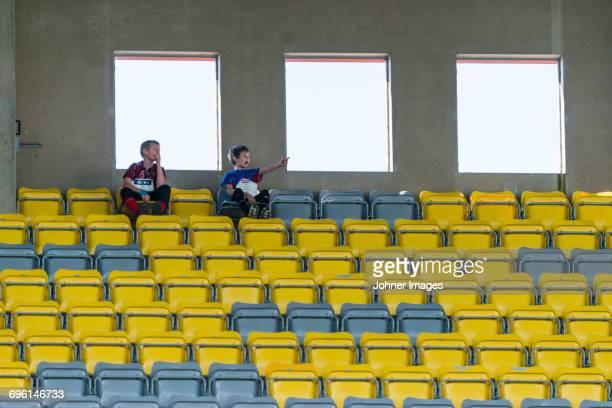 Boys on stadium chairs
