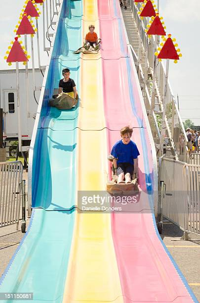 """boys on super-slide at fair - """"danielle donders"""" stock pictures, royalty-free photos & images"""