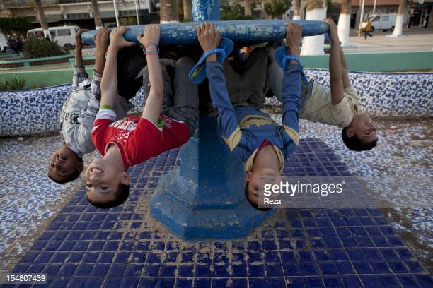 Boys on the fountain in the city center on April 14 in El Malah Algeria The town was formerly known as Rio Salado