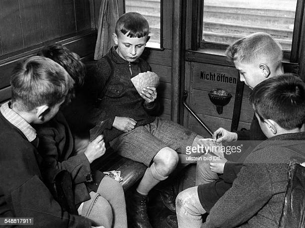 Boys on their way to school playing cards 1940 Photographer Weltrundschau Published by 'Koralle' 25/1940 Vintage property of ullstein bild