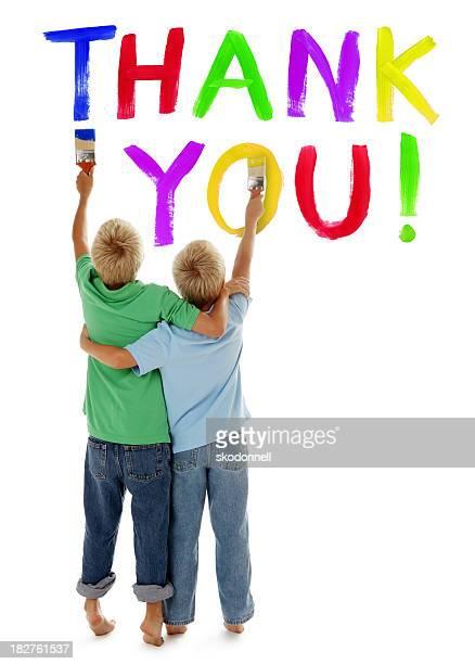garçons peinture vous remercier signe sur blanc - fesse enfant photos et images de collection