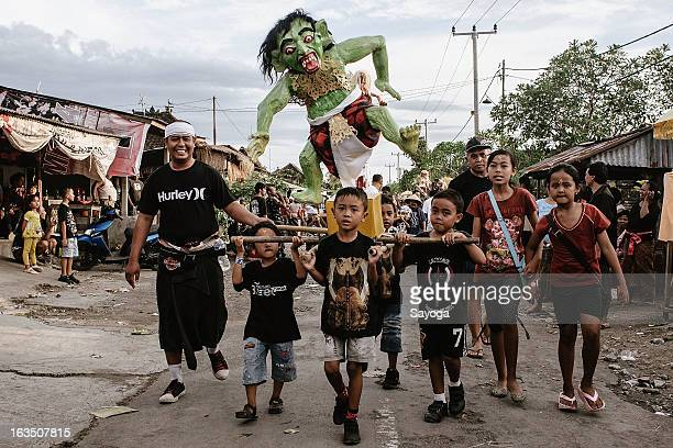 Boys parade with their demon Ogoh-ogoh on March 11, 2013 in Tunjuk Village, Tabanan, Bali, Indonesia. For the Balinese, Ogoh-ogohs reflect the form...