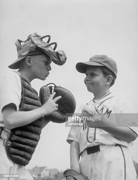 Boys pitcher and catcher talking 1964