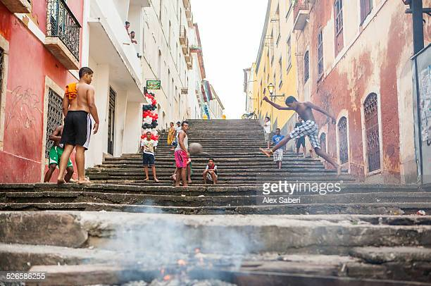 boys play a game of football on a street in sao luis, brazil. - alex saberi stock pictures, royalty-free photos & images