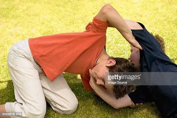 Boys play at wrestling