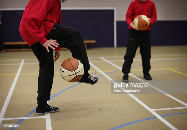 Boys play basketball in the sports hall at a secondary school on December 1 2014 in London England Education funding is expected to be an issue in...