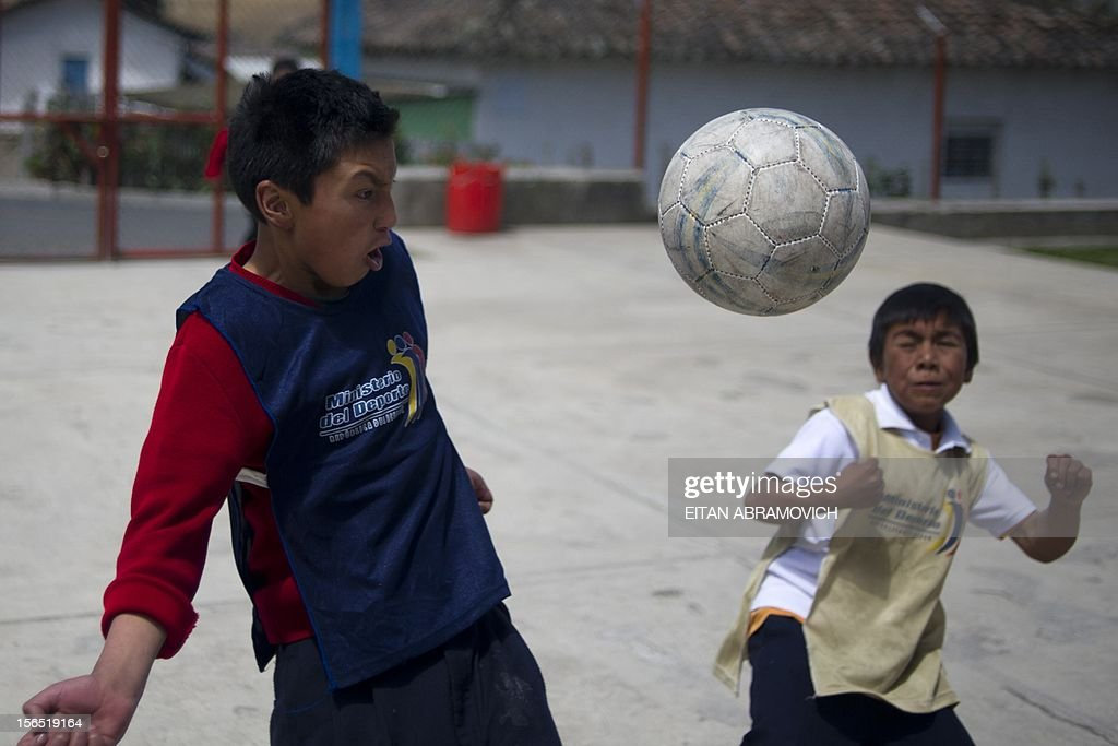 Boys play football at a rural school at La Palizada in Tulcan, Carchi province, in Ecuador close to the Colombian border on November 7, 2012. AFP PHOTO/Eitan Abramovich