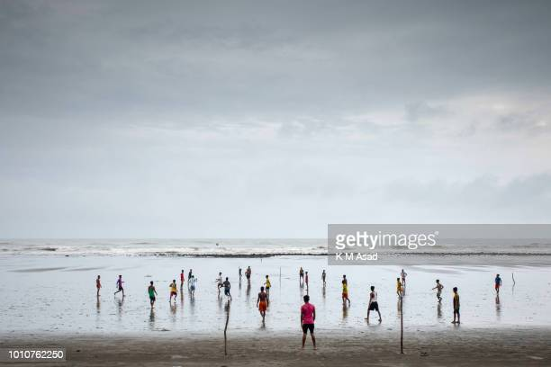 Boys Play football in cox's bazar beach area in Coxs Bazar
