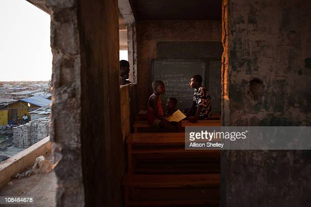 Boys play in a classroom on the second floor of a building on the site of the Fort Dimanche prison where many were held in inhumane conditions under...