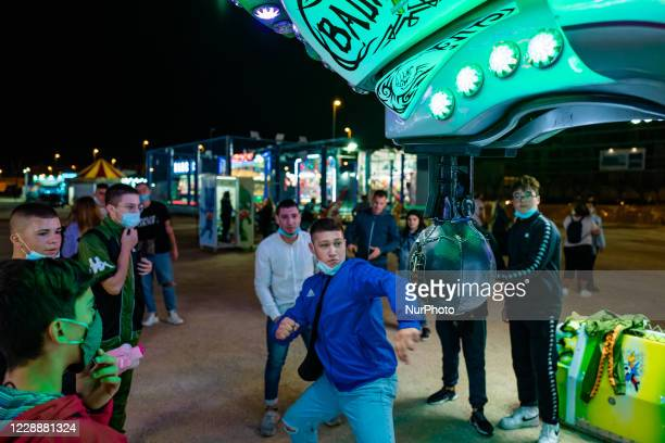 Boys play in an attraction of the Luna Park in Molfetta at Secca dei Pali on 3 October 2020 First day of opening of the Luna Park in Molfetta in the...