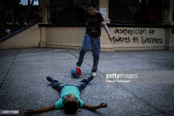 Boys play in the downtown of Chilpancingo a day before the state elections in the Mexican Southern State of Guerrero on June 06 2015 in Chilpancingo...