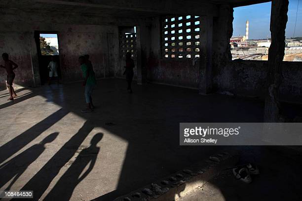 Boys play in the ruins of a building on the site of the Fort Dimanche prison where many were held in inhumane conditions under the regime of...