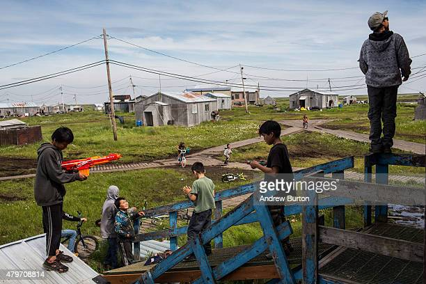 Boys play next to the fresh water storage tank one of the only places to get fresh water in town on July 5 2015 in Newtok Alaska Newtok which is...