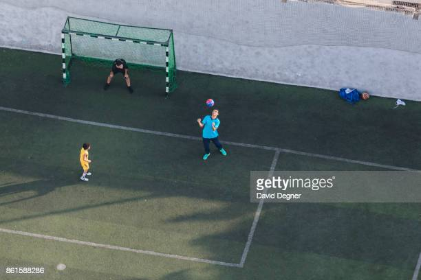 Boys play soccer in a private club on Zamalek on September 24 2017 in Cairo Egypt Overview photos of Cairo's buildings cityscape and infrastructure...